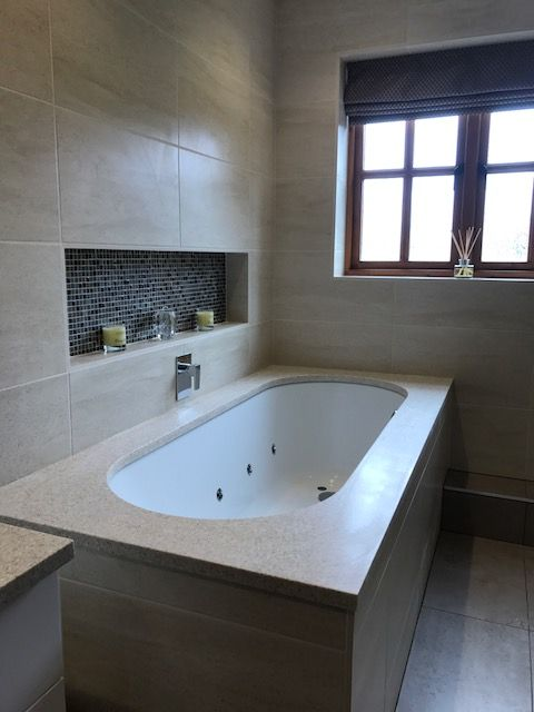 Bespoke Corian Over Bath Surround