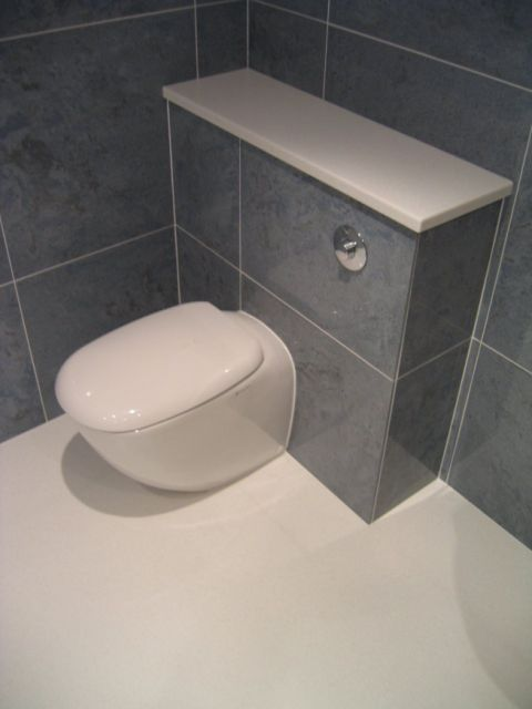 Corian Wet Room floor under WC and Cistern Cover