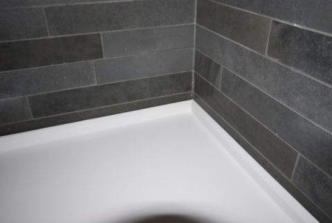 Shower detail to tiled wall