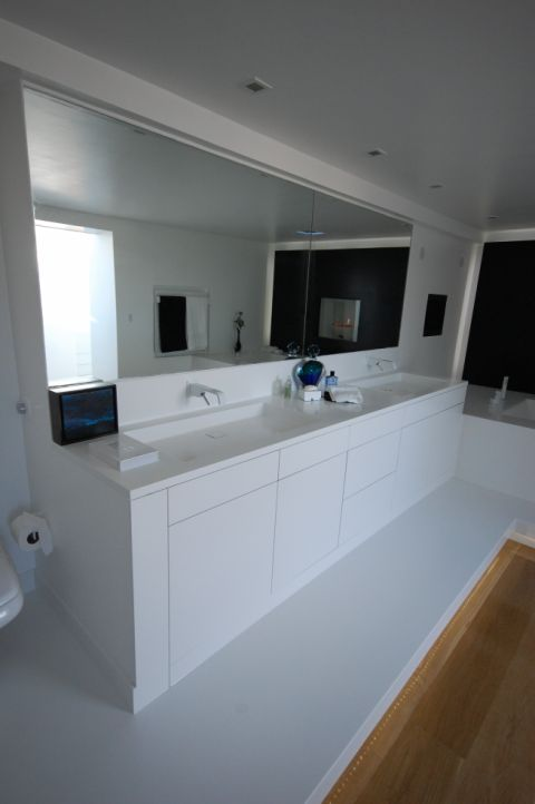 HI-MACS made to measure vanity top with bespoke bathroom sink