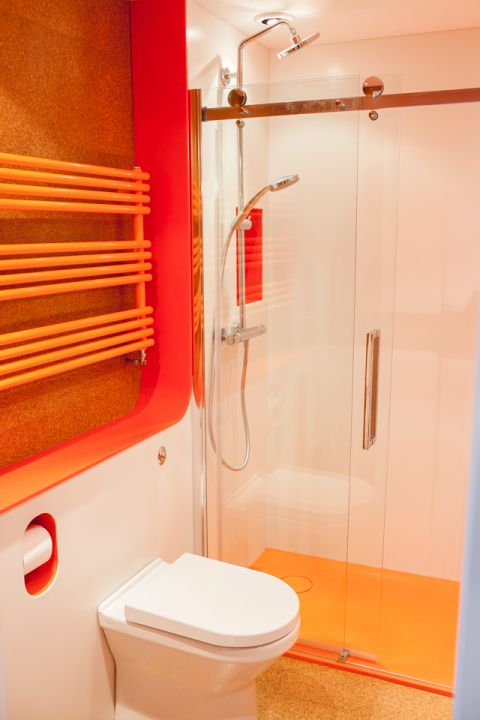 Hi-MACS Ivory White Wall Panels in Orange Bathroom