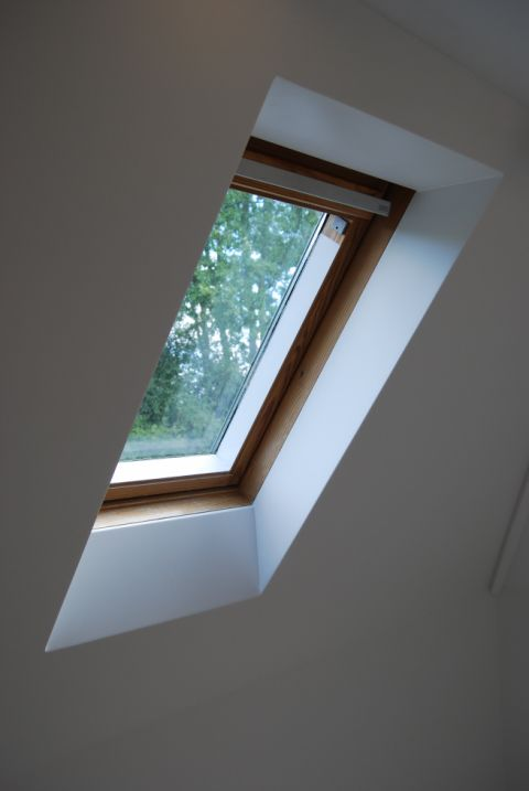 Seamless Wall Panel Junction with Velux Window Reveal
