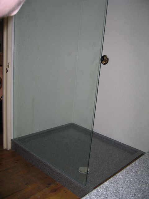 H-MACS Greystone Granite Custom Shower Tray with HI-MACS Gemini Wall Panels