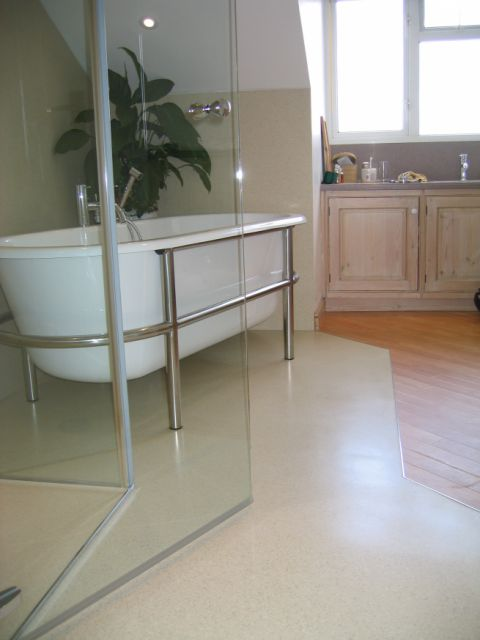 bespoke HI-MACS wet room floor join with laminate