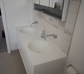 Double Basin Vanity Wrapped in Glacier White Corian