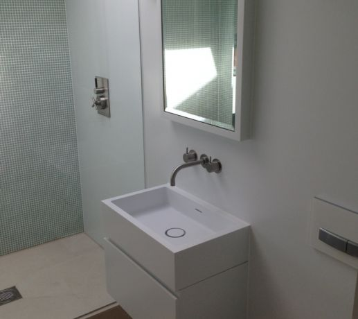 Corian Recessed Mirror Cabinet integral to Corian Walls