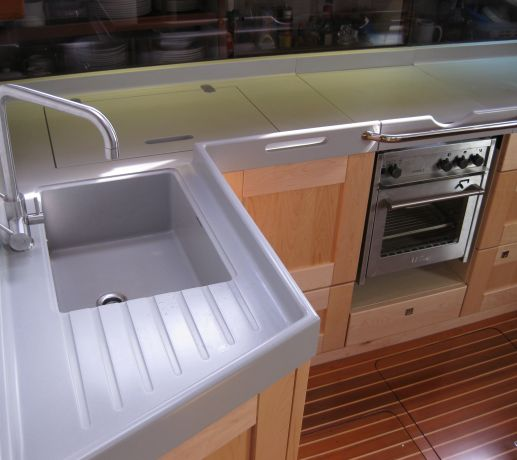 Yacht galley worktops with raised waterfall edge