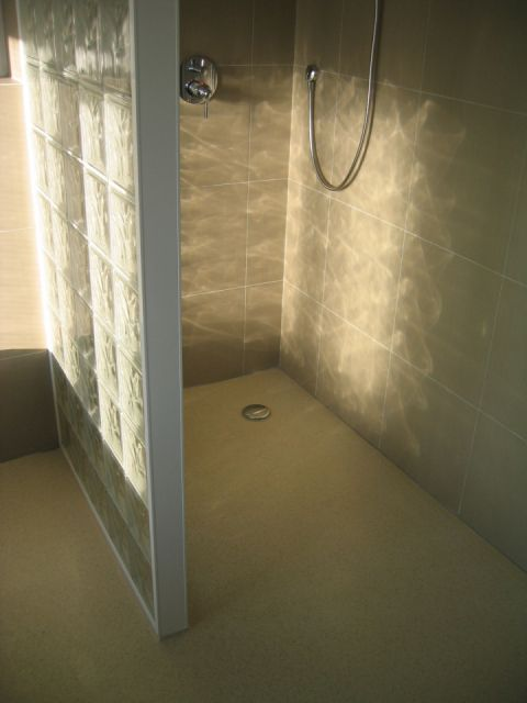 Coloured Bespoke Wet Room Floor with Coved Platform for Glass Brick Wall