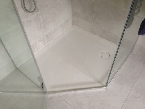 Bespoke Angled Shower Tray in Veined Corian