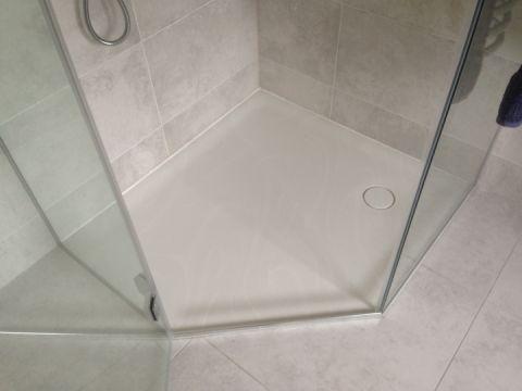 Bespoke Angled Shower Tray in Veined Corian