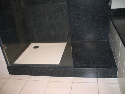 Black and White Shower Tray with Draining Area