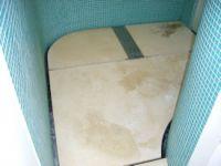 stained limestone wetroom floor